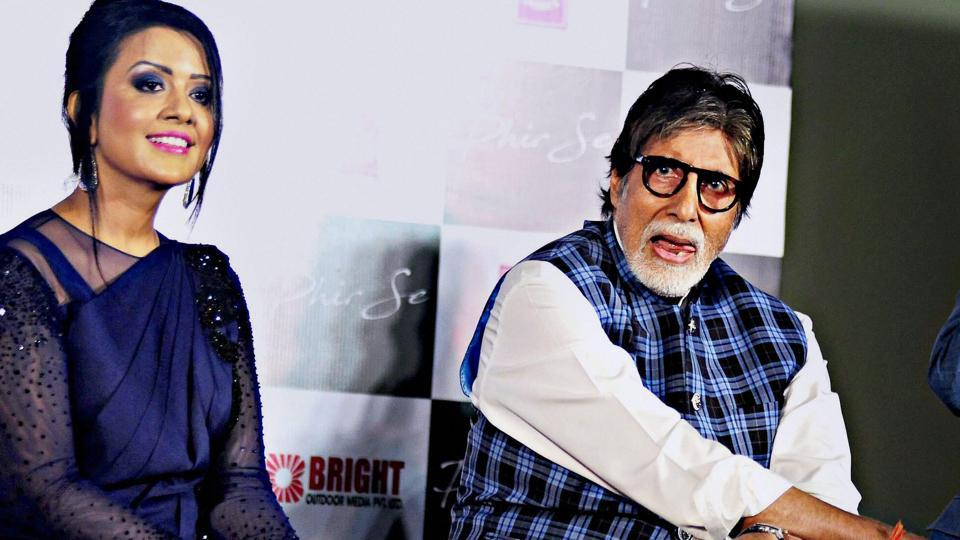 Amitabh Bachchan with Maharashtra Chief Minister Devendra Fadnavis' wife Amruta Fadnavis during the song launch 'Phir Se' in Mumbai on Wednesday.
