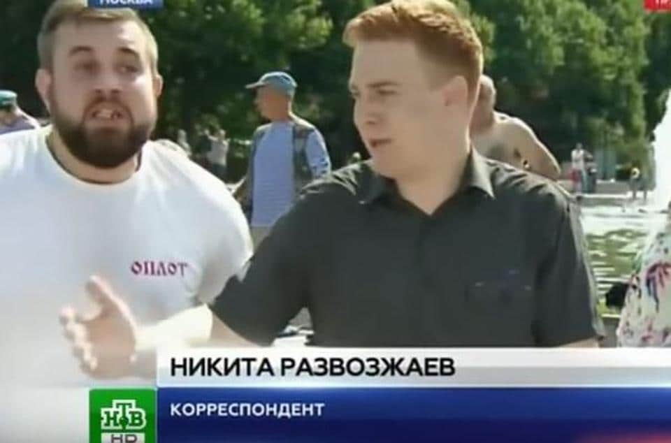 Nikita Razvozzhayev (right), just before he was punched by his assailant (left).