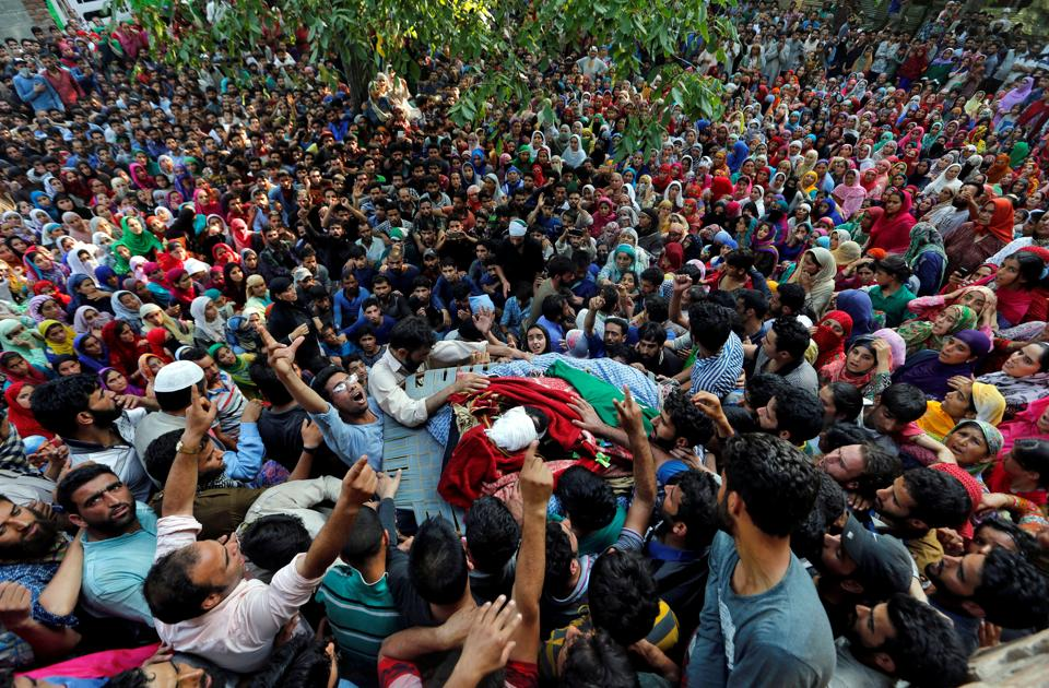 People shout slogans as they gather around the body of Shabir Ahmad Mir, a suspected militant, who was killed in a gunbattle with Indian security forces at Tahab village of Pulwama district.