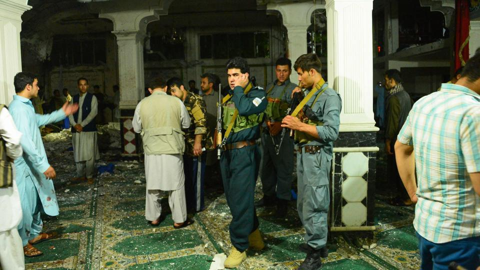 Afghan security personnel inspect the site after the suicide bomb attack at a Shiite mosque in Herat. (Hoshang Hashimi / AFP)