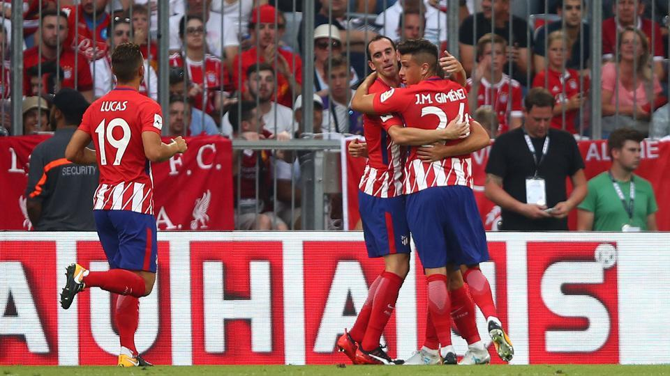 Atletico Madrid's Luciano Vietto celebrates with teammates after scoring the winner against Napoli in their Audi Cup match on Tuesday.