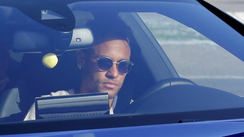 Brazilian football player Neymar drives to arrive at the Joan Gamper training camp near Barcelona.