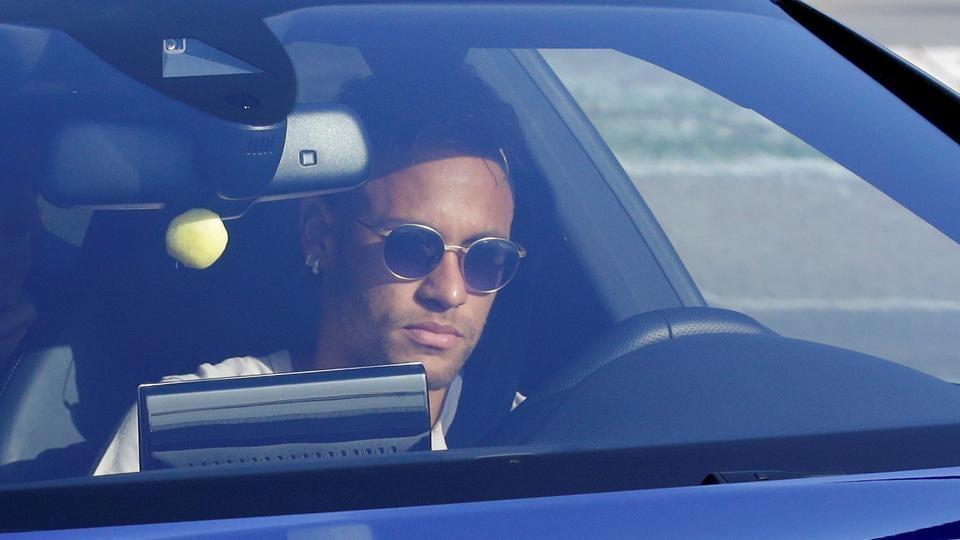Brazilian football player Neymar drives to arrive at the Joan Gamper training camp near Barcelona.