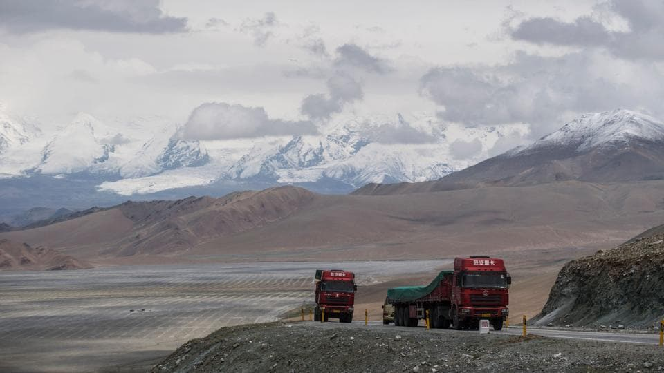 In June, on the 300 kilometre trip between Kashgar and Tashkurgan, drivers were stopped at six police checkpoints, while their passengers had to walk through metal detectors and show identification cards. Signs warn that officials can check mobile phones for 'illegal'  religious content. (Johannes EISELE / AFP)