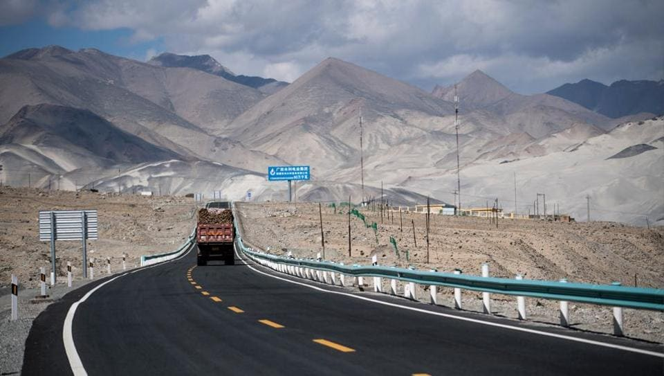 A truck driving along the China-Pakistan Friendship Highway before the Karakorum mountain range near Tashkurgan. For China, the two-lane thoroughfare symbolizes a blossoming partnership, nourished with tens of billion of dollars of infrastructure investment. But for many Pakistani businessmen living and working on the Chinese side of the border, the road is a one way street. (Johannes EISELE  / AFP)