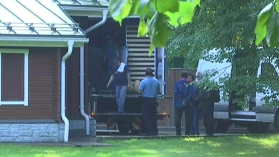 A still image taken from a video footage shows men loading a truck at a dacha compound used by US diplomats for recreation, in Serebryany Bor residential area in the west of Moscow, Russia.