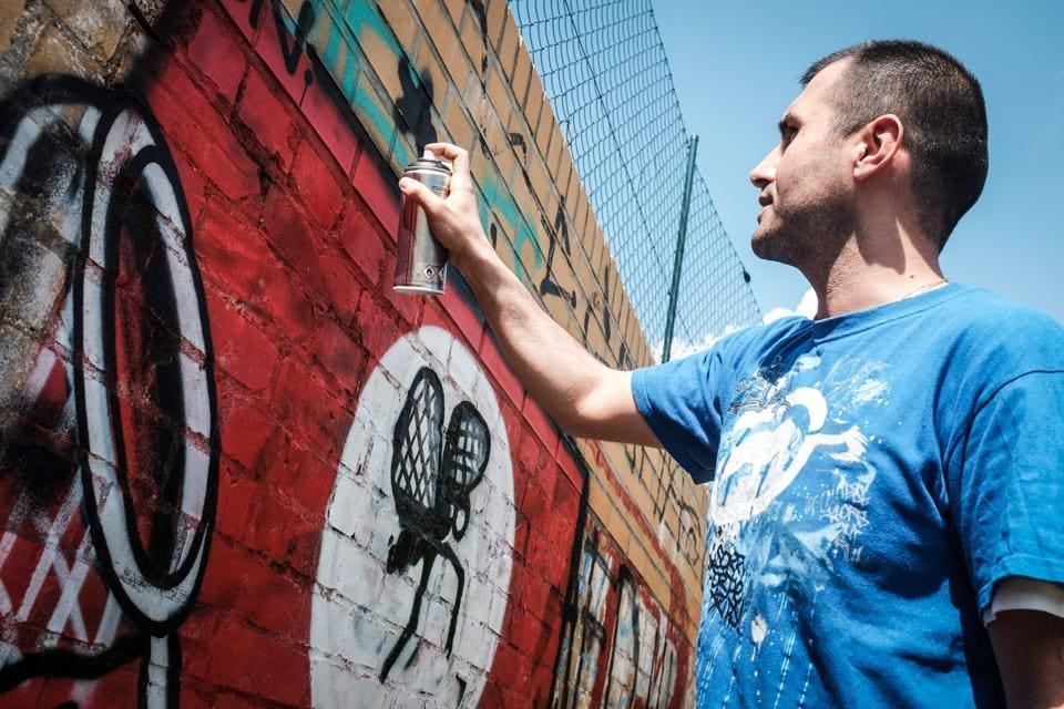 Berlin street artists,neo-Nazi graffiti,swastika