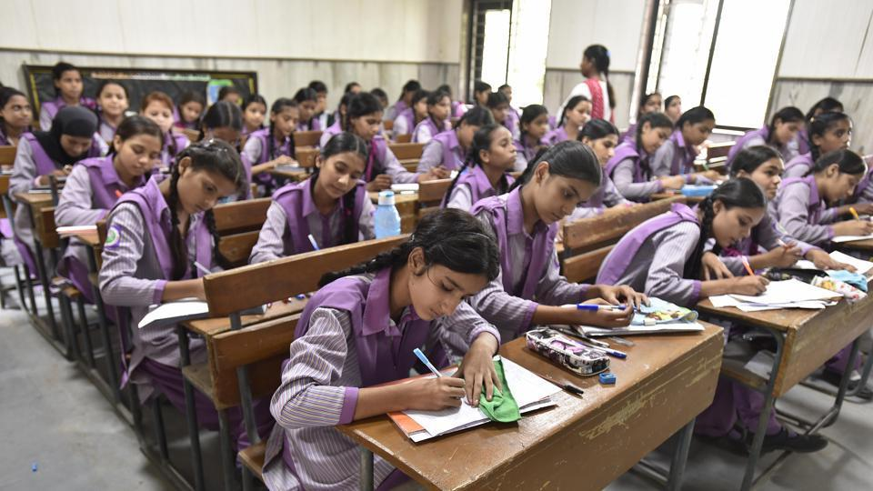 Under the existing no-detention policy, students are automatically promoted  to the next class until the standard eight.