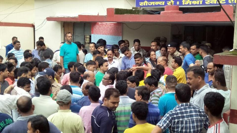 Locals protest outside the police station in Satpuli.
