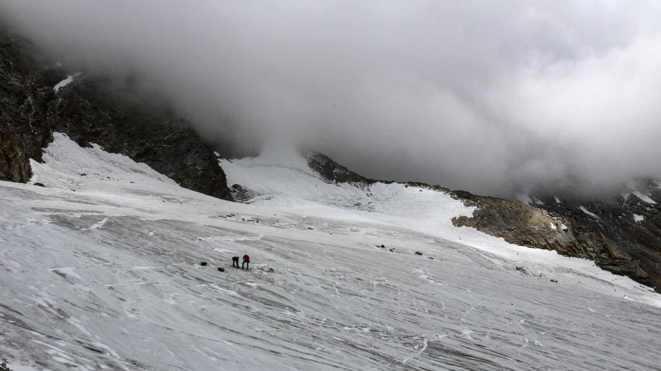 A handout picture released on Wednesday by the Swiss Police of Canton Valais shows the Hohlaub Glacier in the Canton of Valais where the remains of a German backpacker, who died 30 years ago while climbing the Swiss Alps, were found by two alpinists.