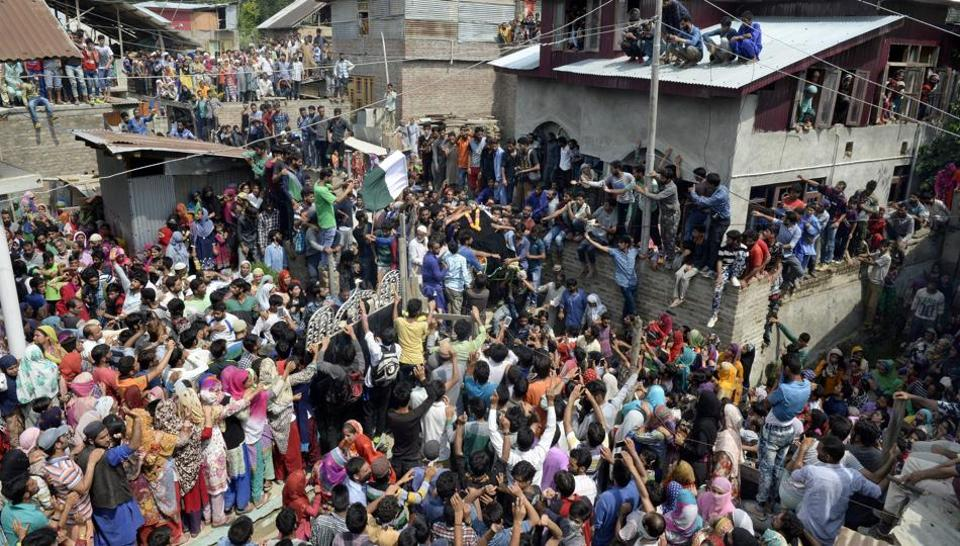 Kashmiri villagers carry the body of suspected militant Arif Lelhari, who was killed along with top LeT leader Abu Dujana, during his funeral in the Lelhar village of Pulwama.