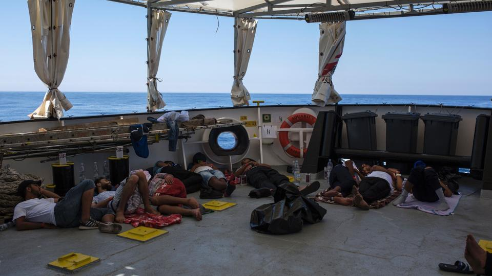 Migrants from Libya sleep on deck of the Aquarius rescue ship run by NGO SOS Mediterranee and Medecins Sans Frontieres (MSF) after their rescue, in the Mediterranean Sea on August 2.
