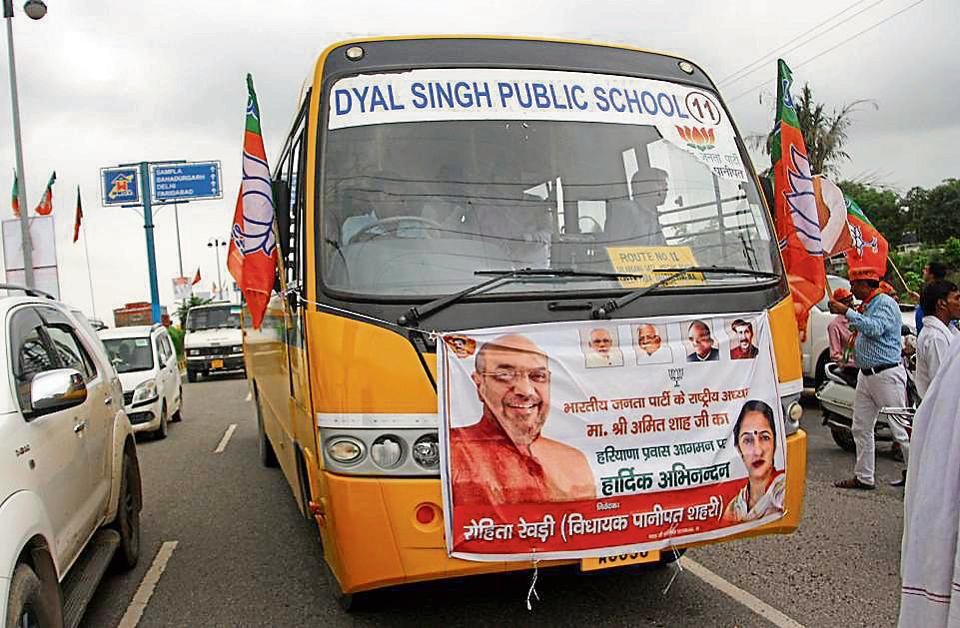 A school bus ferrying people to a BJP rally to welcome Amit Shah in Rohtak on Wednesday.
