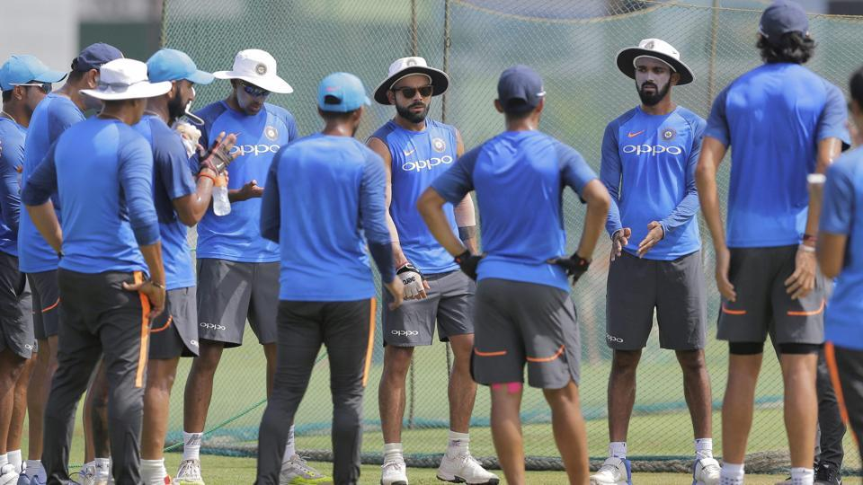 India captain Virat Kohli, center facing camera, speaks to his team members during a training session ahead of their second test cricket match with Sri Lanka in Colombo.