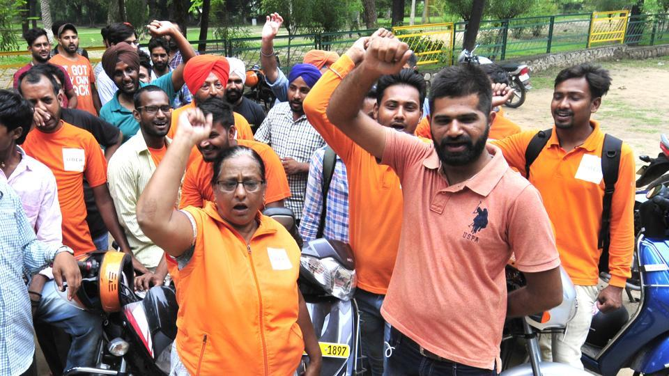 Uber 'baxi' drivers protest against the company in Phase 9, Mohali, on Wednesday.