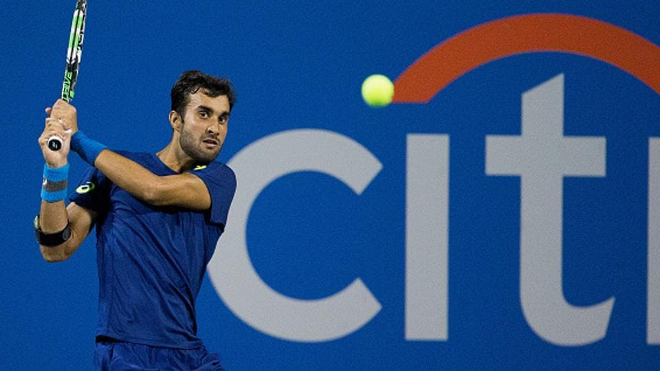 Yuki Bhambri returns to Gael Monfiles during their second round match of the Citi Open at the HG FitzGerald Tennis Center in Washington on Wednesday.