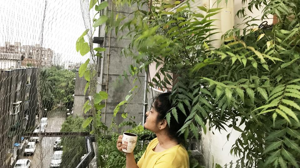 Payal Singh enjoys a cup of tea at her balcony in Vasundhara Valley Apartments.