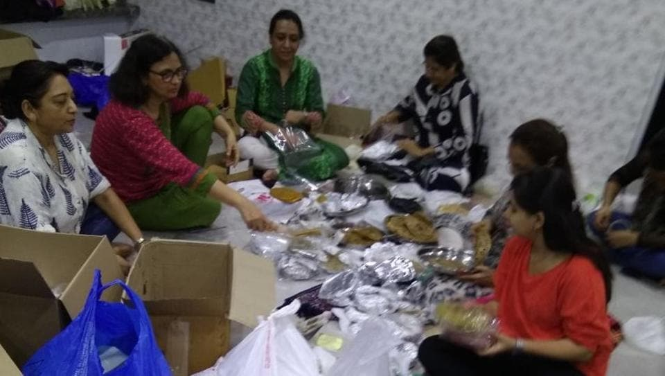 Members of Food Army sorting through thepla packets at founder Rintu Rathod's house in Santacruz (West)on Wednesday.