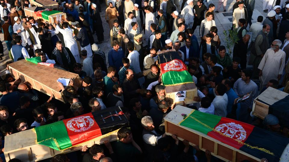 Afghan protesters carry coffins of victims as they shout against the Islamic State group following a mosque attack that killed 33 people in Herat on August 2, 2017.