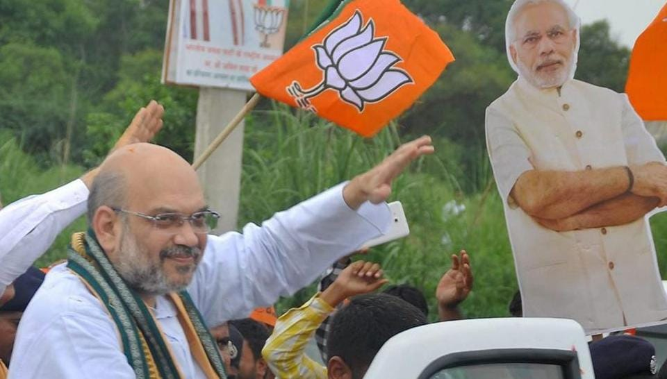 BJP President Amit Shah being welcomed on his arrival in Rohtak on Wednesday.
