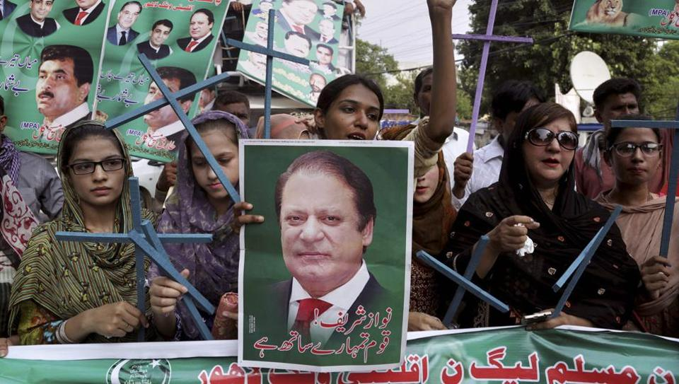 Supporters of Pakistan's deposed Prime Minister Nawaz Sharif chant slogans at a rally to condemn the dismissal of their leader, in Lahore, Pakistan, Saturday, July 29, 2017.