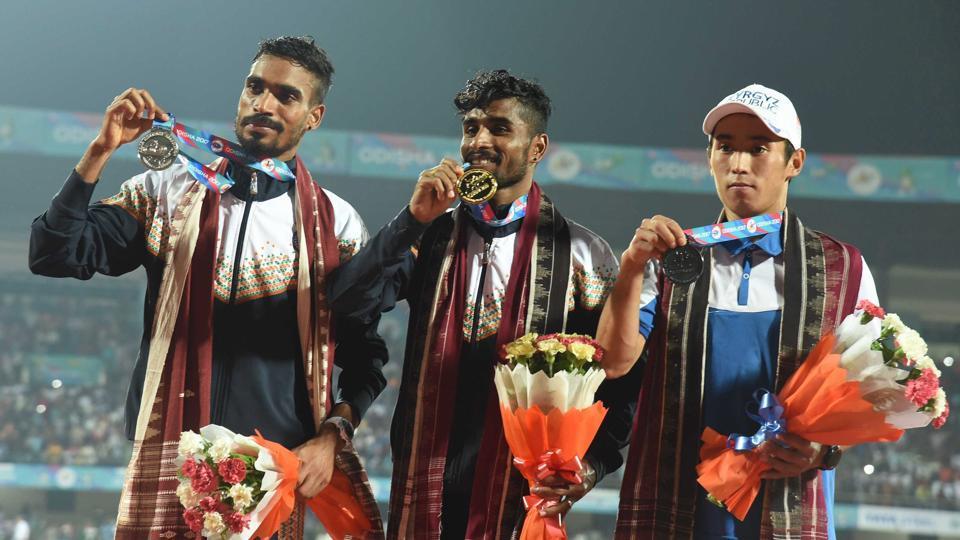 India G Lakshmanan (C) won a gold medal in the 10,000 metres run at the Asian Athletics Championships in Bhubaneswar.