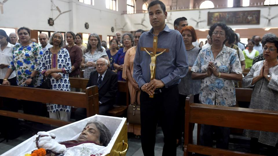 Family members and friends gather for the funeral prayers of Eunice de Souza inMumbai on Wednesday.
