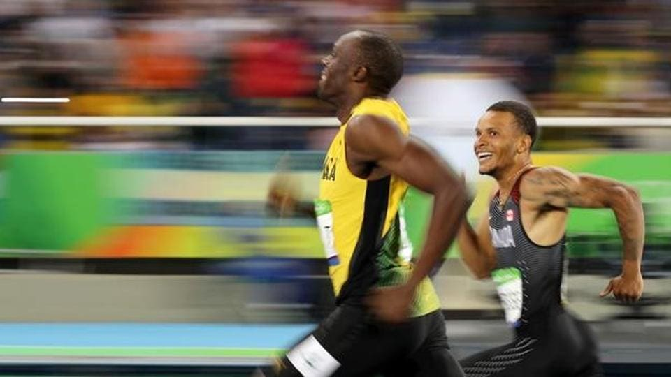 Usain Bolt and Andre De Grasse during the 200m semifinal at the Rio Olympics last year (file photo).