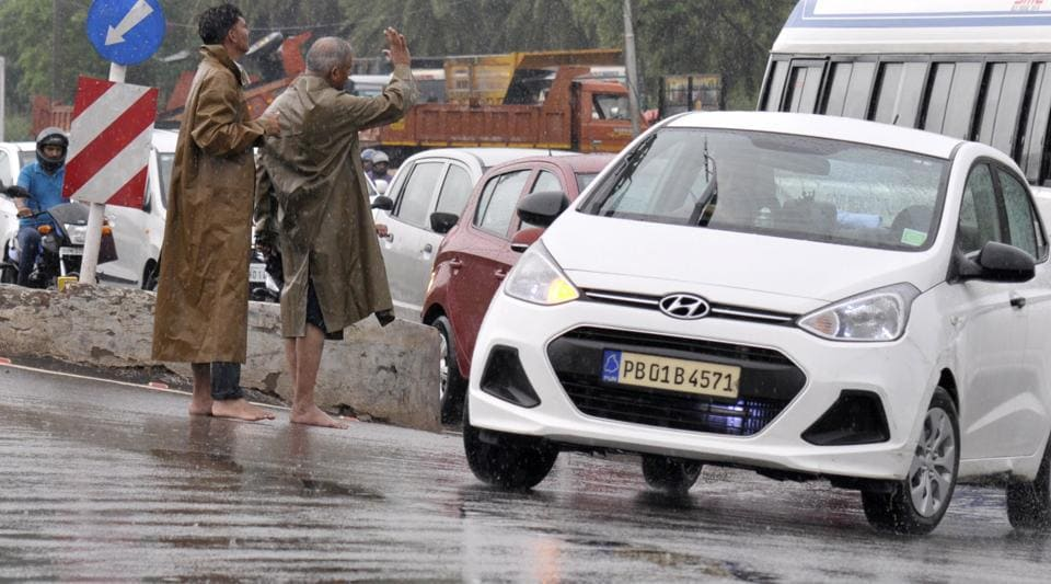 Traffic police standing barefoot at an intersection in Chandigarh on Wednesday.