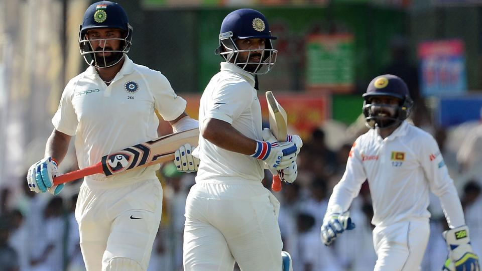 Indian cricketers Ajinkya Rahane (C) and Cheteshwar Pujara (L) scored centuries on the first day of the second Test against Sri Lanka at the Sinhalease Sports Club (SSC) Ground in Colombo on Thursday.