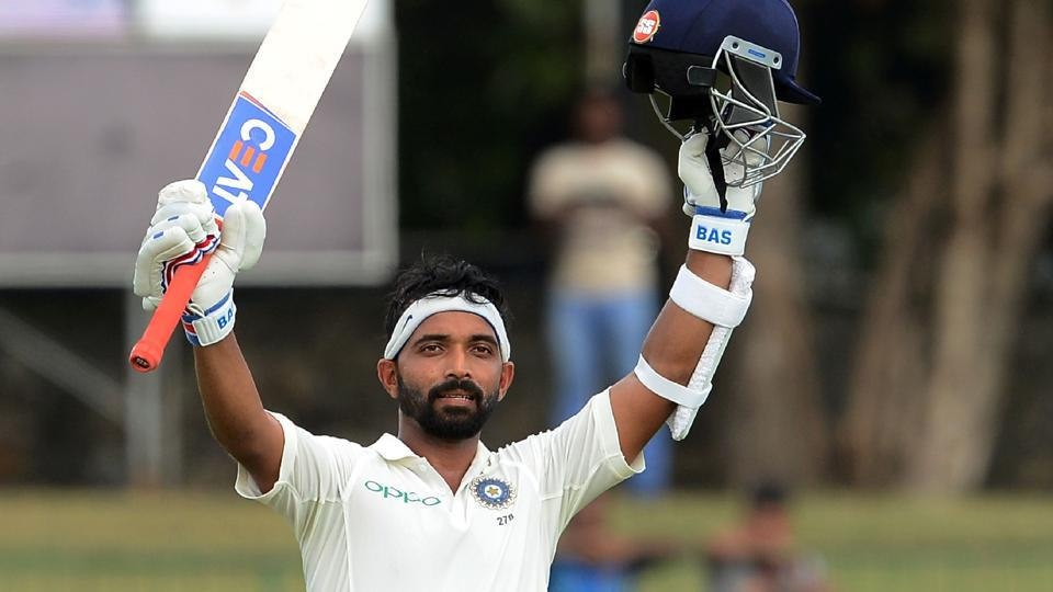 India's Ajinkya Rahane raises his bat and helmet in celebration after scoring a century during the first day of the second Test match against Sri Lanka at the Sinhalease Sports Club (SSC) Ground in Colombo on Thursday.