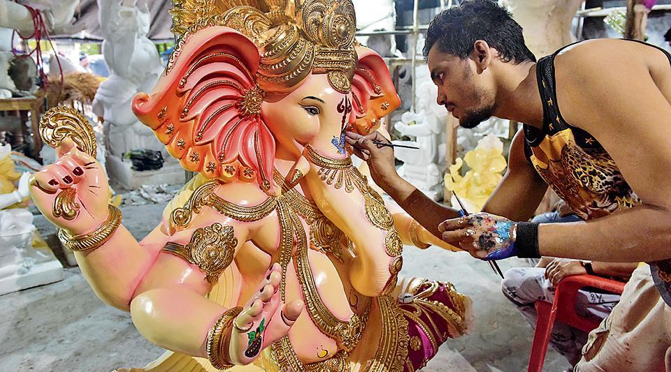 An artiste gives finishing touches to a Ganesha idol in Navi MUmbai on Thursday.