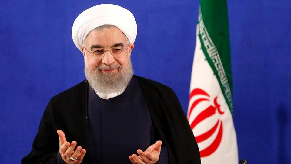 (FILES) This file photo taken on May 22, 2017 shows Iranian President Hassan Rouhani arriving to hold a press conference in Tehran. Rouhani was officially sworn in for a second term on August 3, 2017 at a ceremony overseen by supreme leader Ayatollah Ali Khamanei.
