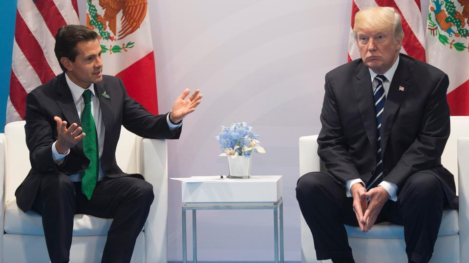 This file photo taken on July 7, 2017, shows US President Donald Trump and Mexican President Enrique Pena Nieto holding a meeting on the sidelines of the G20 Summit in Hamburg, Germany.