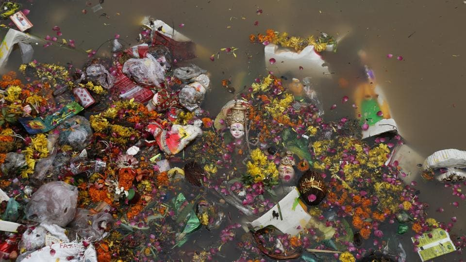 Idols of Hindu goddess Dashama float among flowers, fruit and material offerings along with plastic waste in the waters of the Sabarmati in Ahmedabad, India. The practice of immersing idols into water bodies is observed across India during a number of festivals. The impact on the water bodies' health however stems from inadequate attention to clean-up measures and the impact of waste and dyes on ecology. (Ajit Solanki / AP)