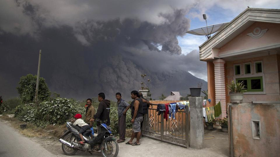 Thick, hot ash fell on nearly a dozen local villages, prompting at least one school in Kuta Rakyat to send students home.  (AP)