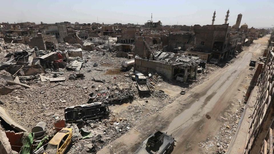 A picture taken on July 30, 2017 shows damaged buildings in the old city in western Mosul. With Mosul in ruins and nearly a million displaced, Iraq now faces the enormous task of restoring order and rebuilding its second city.