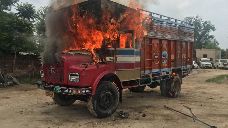 The burning truck inNakodar on Wednesday. Truckers also blocked the Moga-Shahkot road for half-an-hour.