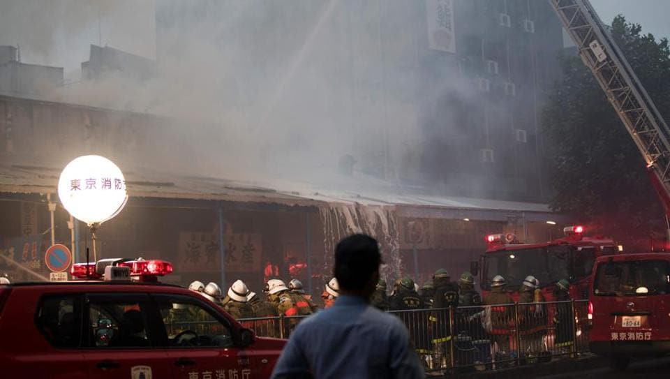 Japanese firefighters try to extinguish a fire at Tokyo's Tsukiji fish market on August 3.