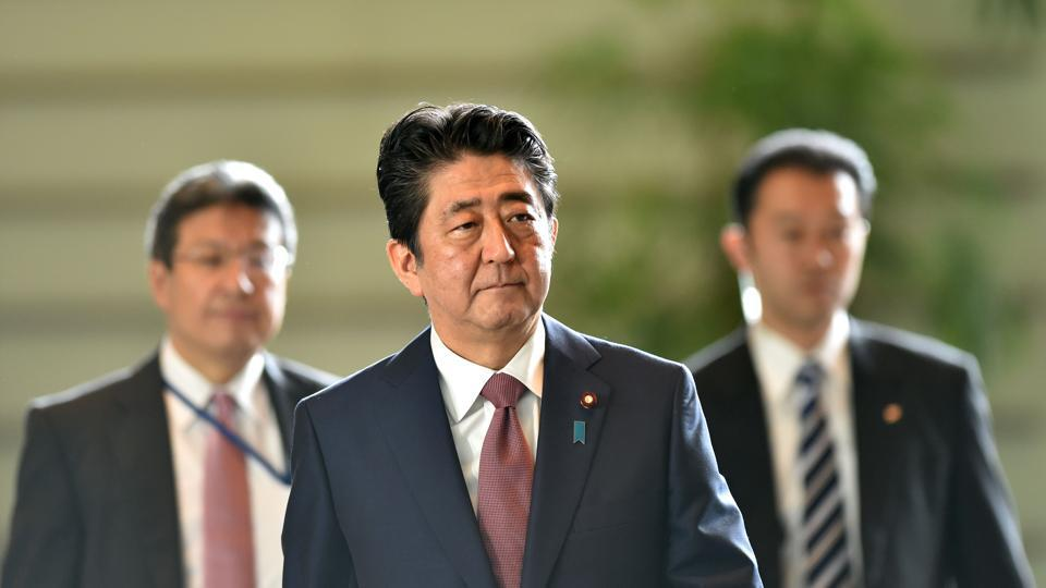 Japan's Prime Minister Shinzo Abe (C) arrives at his official residence to attend a cabinet meeting in Tokyo on August 3, 2017. Abe will shake up his cabinet on August 3, as public support plummets after a series of scandals.