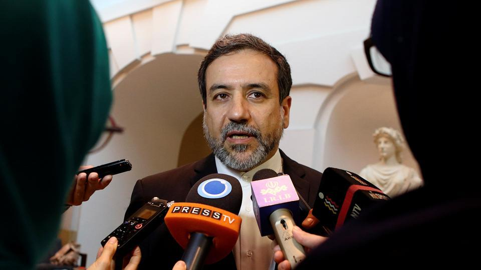 FILE PHOTO: Iran's top nuclear negotiator Abbas Araqchi talks to journalists after meeting senior officials from the United States, Russia, China, Britain, Germany and France in a hotel in Vienna, Austria, October 19, 2015.