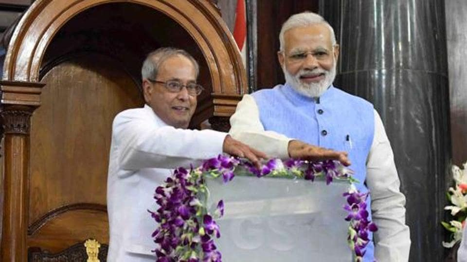 Former President Pranab Mukherjee (left) and Prime Minister Narendra Modi press buttons to launch the 'Goods and Services Tax (GST)' at midnight on May 30 in parliament.