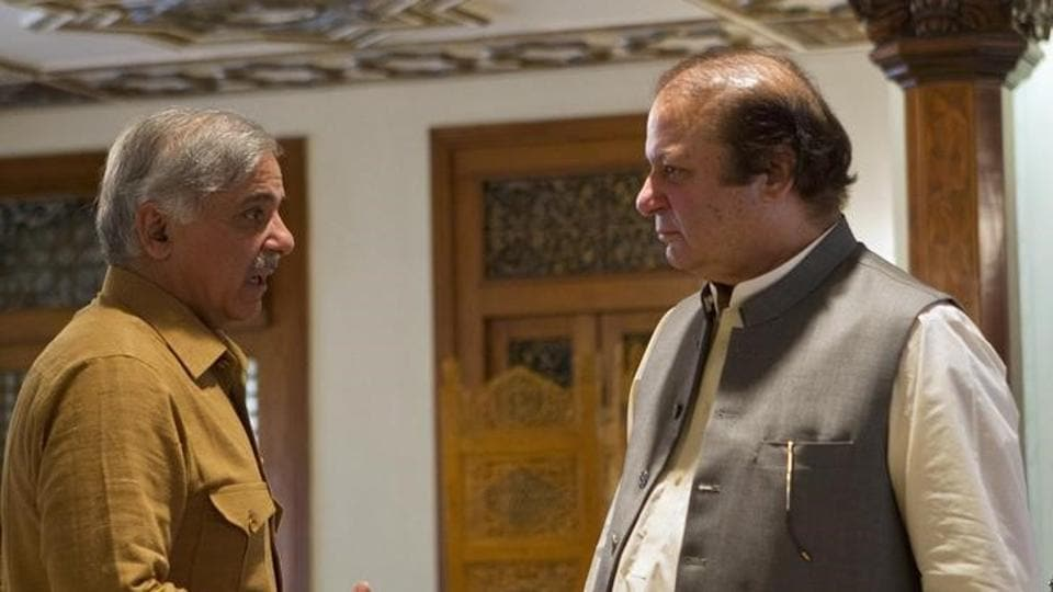 A file photo of Shahbaz Sharif chief minister of Punjab province talks with his elder brother and former Pakistan Prime Minister Nawaz Sharif at the Prime Minister's office in Islamabad on June 14, 2013.