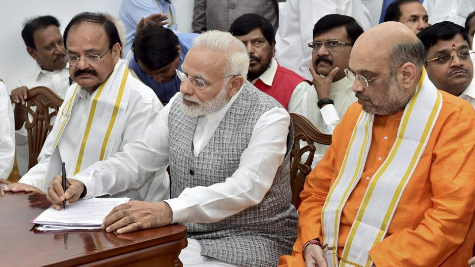 NDA's vice-presidential candidate Venkaiah Naidu (L), with Prime Minister Narendra Modi (C) and BJP president Amit Shah, files his nomination papers at the parliament in New Delhi.