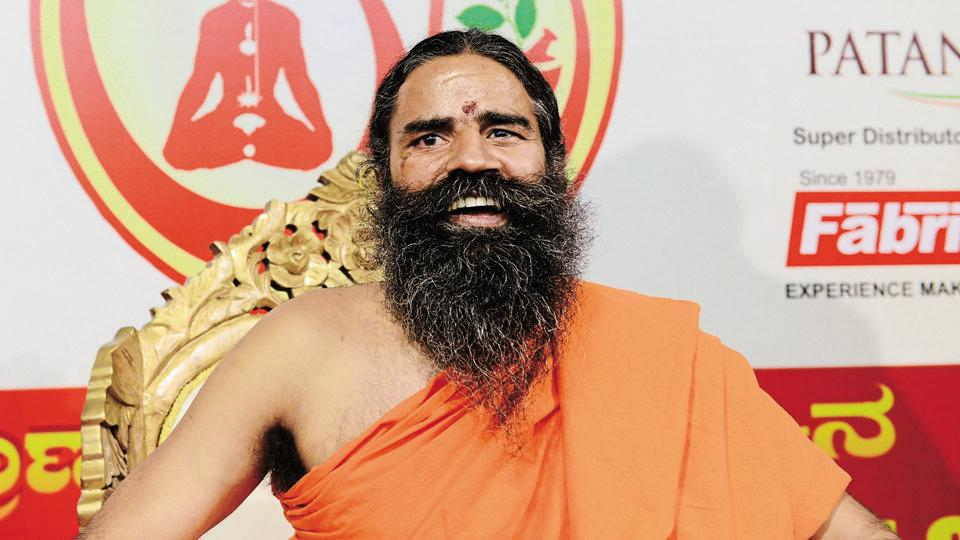 Baba Ramdev a spiritual leader in yoga and Ayurveda addressing a press conference.