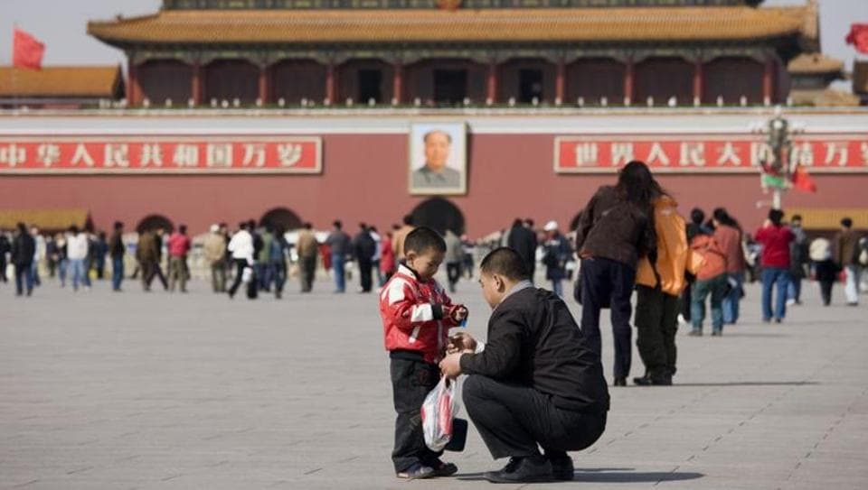 A father and son at Gate of Heavenly Peace, Forbidden City.