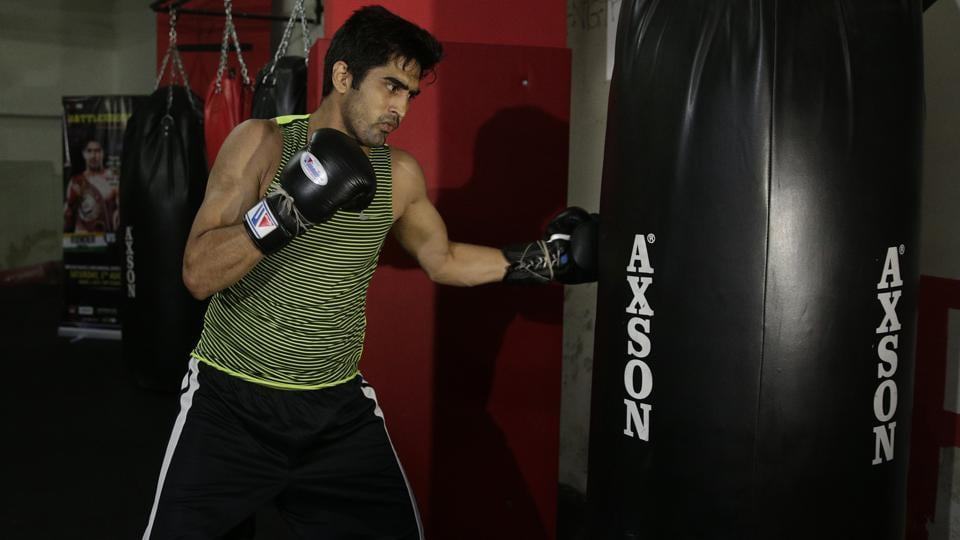 Indian boxer and WBO Asia-Pacific Super Middleweight champion Vijender Singh at a training session in Mumbai ahead of his fight against China's Zulpikar Maimaitiali.