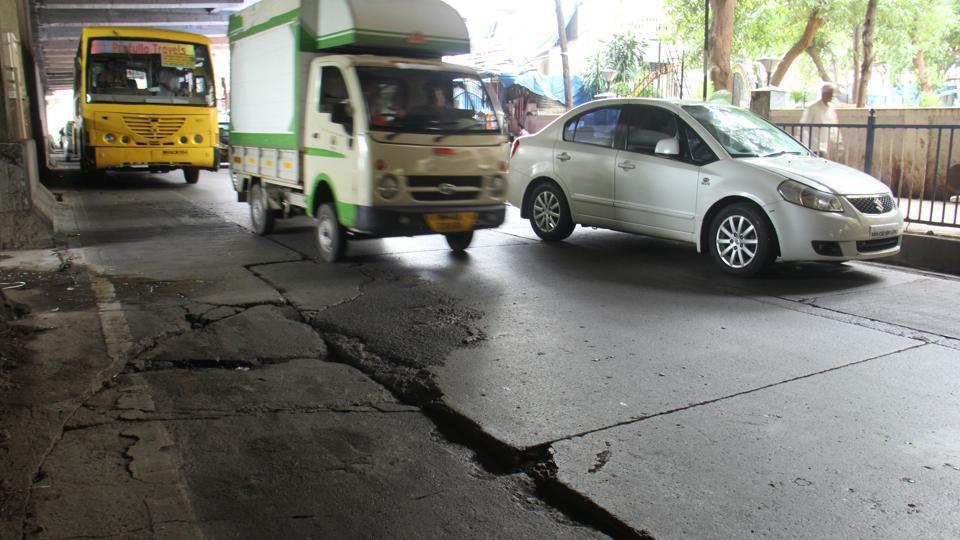 Potholes under Versova Metro railway station at Andheri in Mumbai.