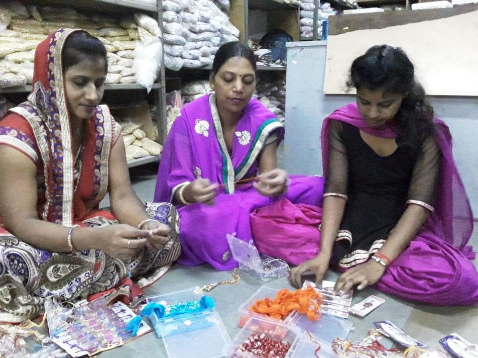 Women make rakhis at their home in Alwar. More than 7,000 women are engaged in preparing rakhis that are priced between Rs 2 and Rs 200.