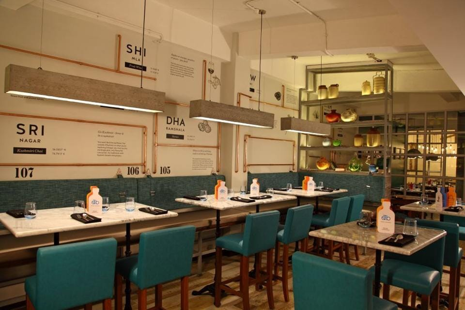 The interiors are a spacious maze of dining zones, including a breezy outdoor area and kitschy interior spaces. Colourful chairs, exposed Edison bulbs and flea market bric-a-brac give it a laidback if banal feel.